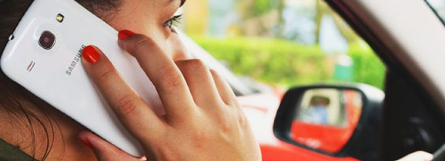 Managing phone use while driving: will switching to silent mode suffice?
